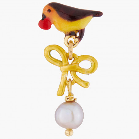 Bird on faceted glass and cherries ring