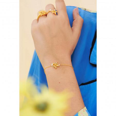Bracelet perlé verre taillé noir et amas de roches en cubes dorés