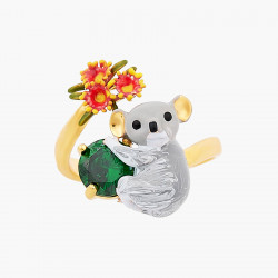 Little snow-covered squirrel on faceted glass necklace
