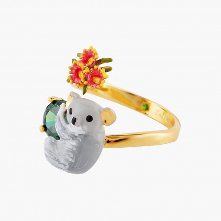 Convertible squirrel on faceted glass ornamented with little flowers and berries necklace